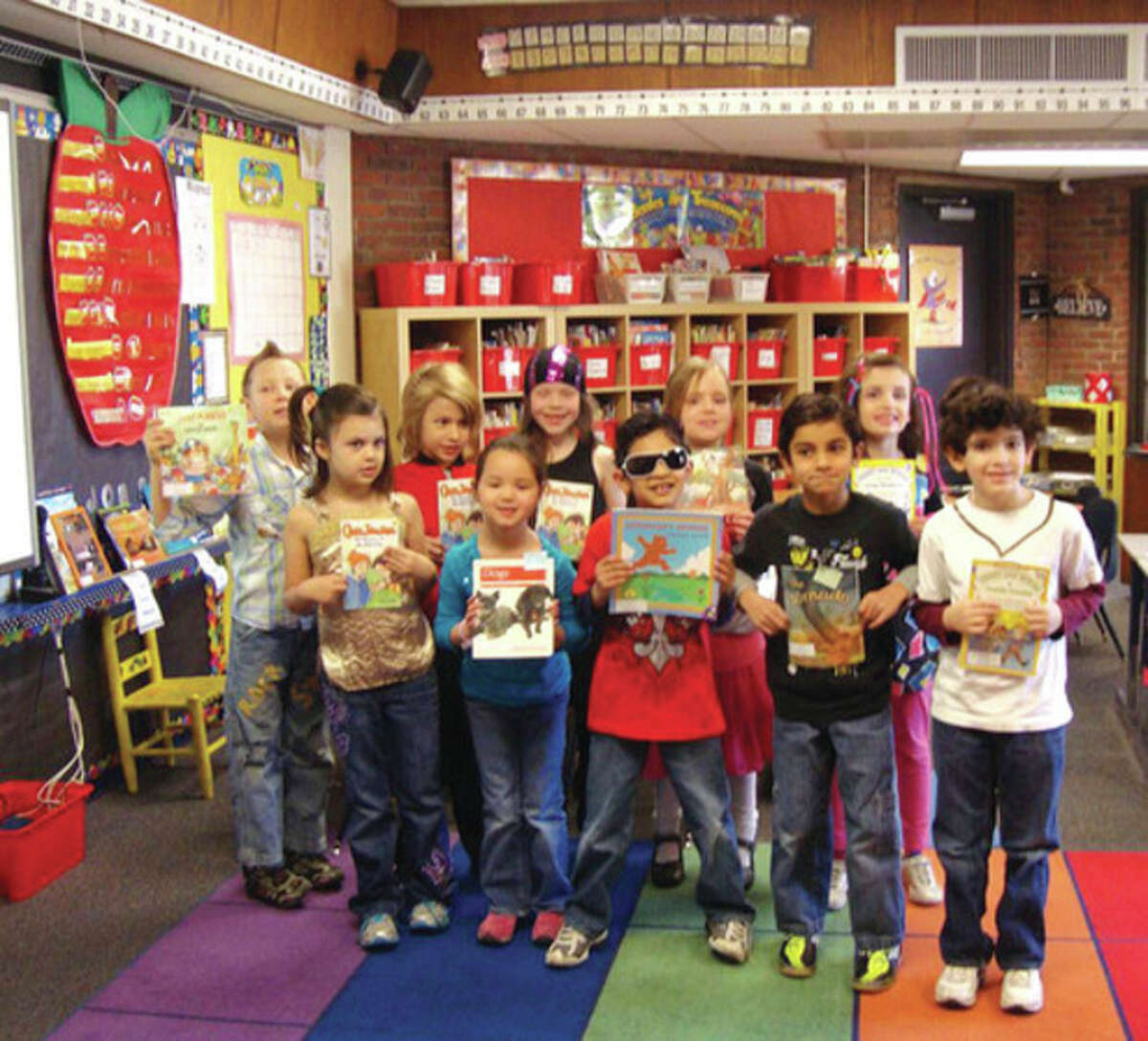 Wilton first graders dress up as their favorite rock stars during the Reading Rocks! initiative. Contributed photo.