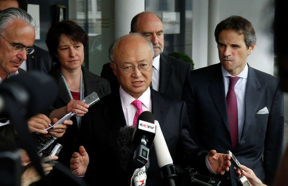 "Director General of the International Atomic Energy Agency, IAEA, Yukiya Amano, center, from Japan speaks to the media after returning from Iran at the Vienna International Airport near Schwechat, Austria, on Tuesday, May 22, 2012. Amano says he has reached a deal with Iran on probing suspected work on nuclear weapons and adds that the agreement will ""be signed quite soon."" (AP Photo/Ronald Zak) / AP"