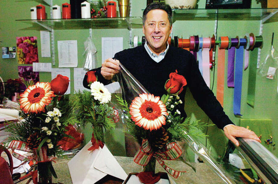 Hour photo / Erik Trautmann Bruce Minoff prepares faces with flowers at one of his Norwalk stores, Bruce's Flowers, on Main Avenue. / (C)2011, The Hour Newspapers, all rights reserved