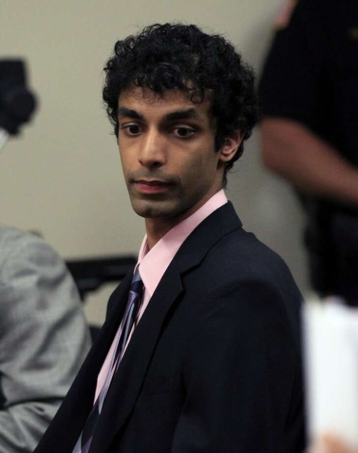 Dharun Ravi sits in court during his sentencing in New Brunswick, N.J., Monday, May 21, 2012. Ravi, a former Rutgers University student who used a webcam to watch his roommate kiss another man days before the roommate killed himself, was sentenced Monday to 30 days in jail. A judge also gave 20-year-old Dharun Ravi three years of probation. (AP Photo/Mel Evans)