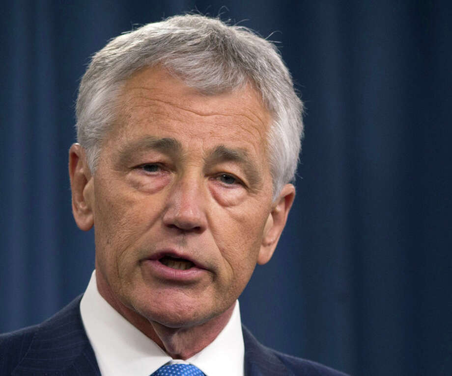 FILE - In this March 1, 2013 file photo, Defense Secretary Chuck Hagel speaks during a news conference at the Pentagon. Hagel plans to announce Friday that the Obama administration has decided to add 14 interceptors on the West Coast to the U.S.-based missile defense system. (AP Photo/Carolyn Kaster, File) / AP