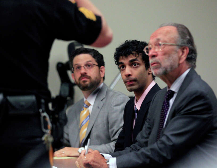Dharun Ravi, center, listens to a court officer with his attorneys Philip Nettl, left, and Steve Altman, during his sentencing in New Brunswick, N.J., Monday, May 21, 2012. Ravi, a former Rutgers University student who used a webcam to watch his roommate kiss another man days before the roommate killed himself was sentenced Monday to 30 days in jail. A judge also gave 20-year-old Dharun Ravi three years of probation. (AP Photo/Mel Evans) / AP