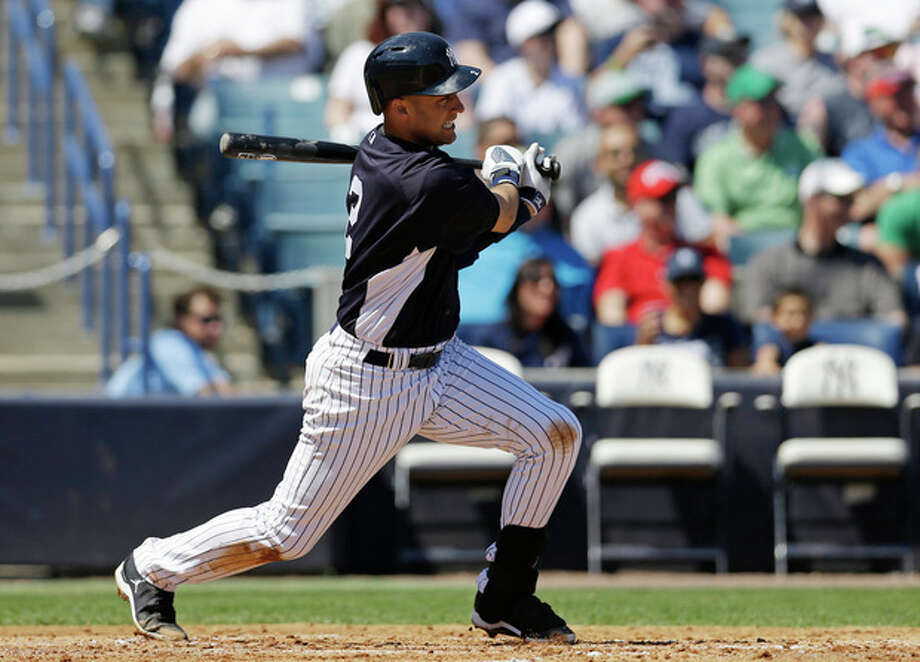 New York Yankees' Derek Jeter hits a single during the third inning of a spring training baseball game against the Miami Marlins in Tampa, Fla., Friday, March 15, 2013. (AP Photo/Kathy Willens) / AP
