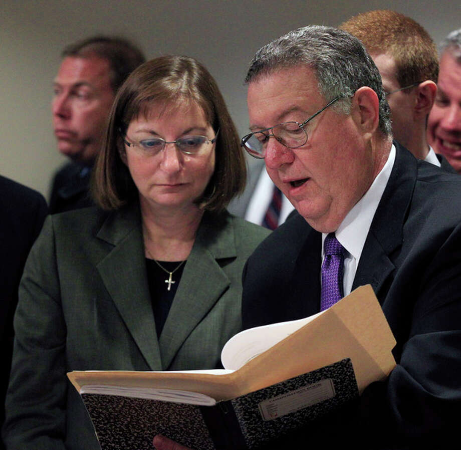 Tyler Clementi's parents Joseph and Jane Clementi, look through some papers before making victim statements during a sentencing hearing for Dharun Ravi, in New Brunswick, N.J., Monday, May 21, 2012. Ravi, a former Rutgers University student who used a webcam to watch his roommate, Tyler Clementi, kiss another man days before the roommate killed himself was sentenced Monday to 30 days in jail. A judge also gave 20-year-old Dharun Ravi three years of probation. (AP Photo/Mel Evans) / AP