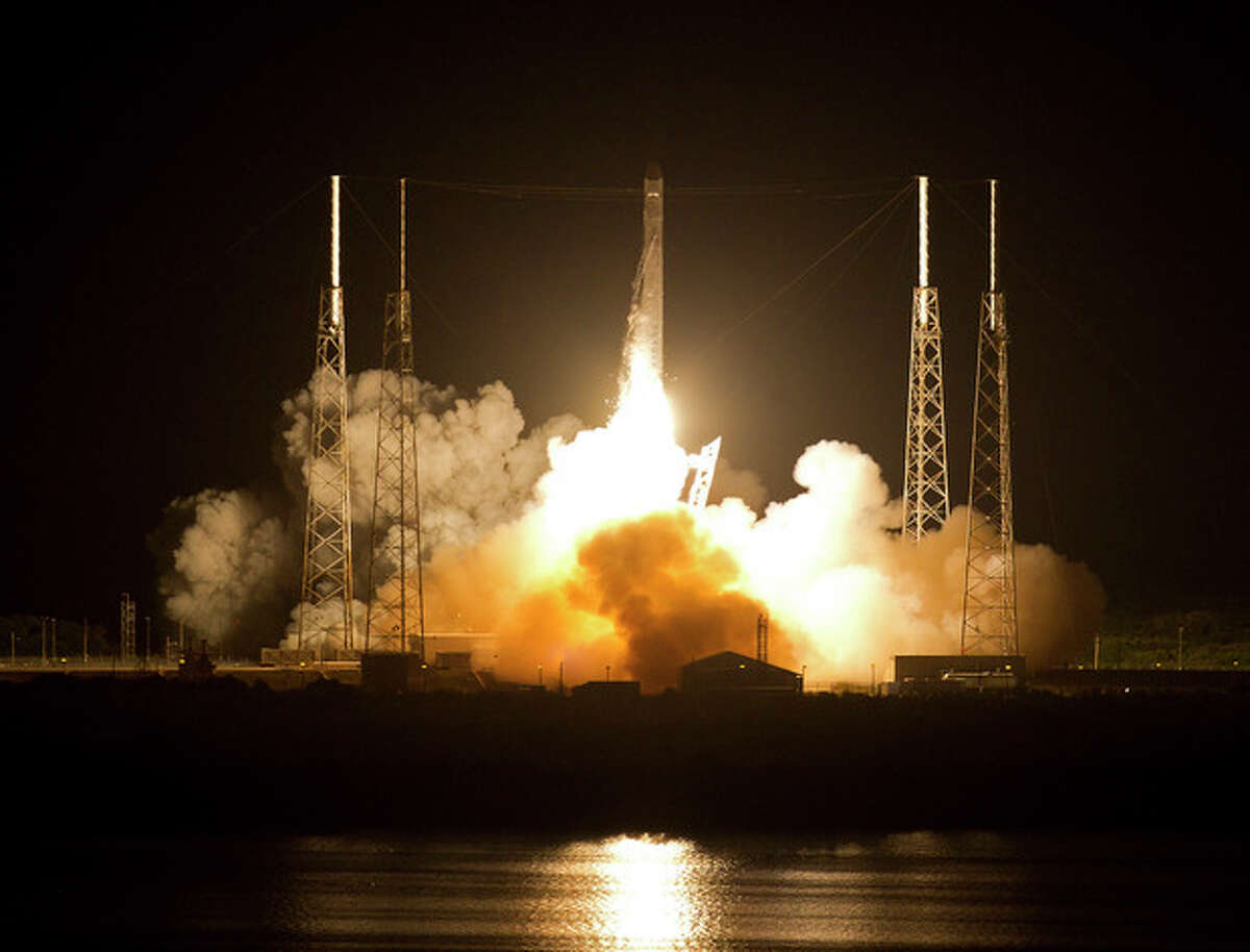 The Falcon 9 SpaceX rocket lifts off from space launch complex 40 at the Cape Canaveral Air Force Station in Cape Canaveral, Fla., early Tuesday, May 22, 2012. This launch marks the first time, a private company sends its own rocket to deliver supplies to the International Space Station.(AP Photo/John Raoux)