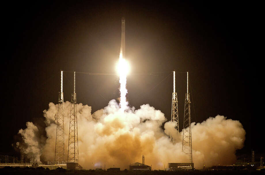 The Falcon 9 SpaceX rocket lifts off from space launch complex 40 at the Cape Canaveral Air Force Station in Cape Canaveral, Fla., early Tuesday, May 22, 2012. This launch marks the first time, a private company sends its own rocket to deliver supplies to the International Space Station.(AP Photo/John Raoux) / AP