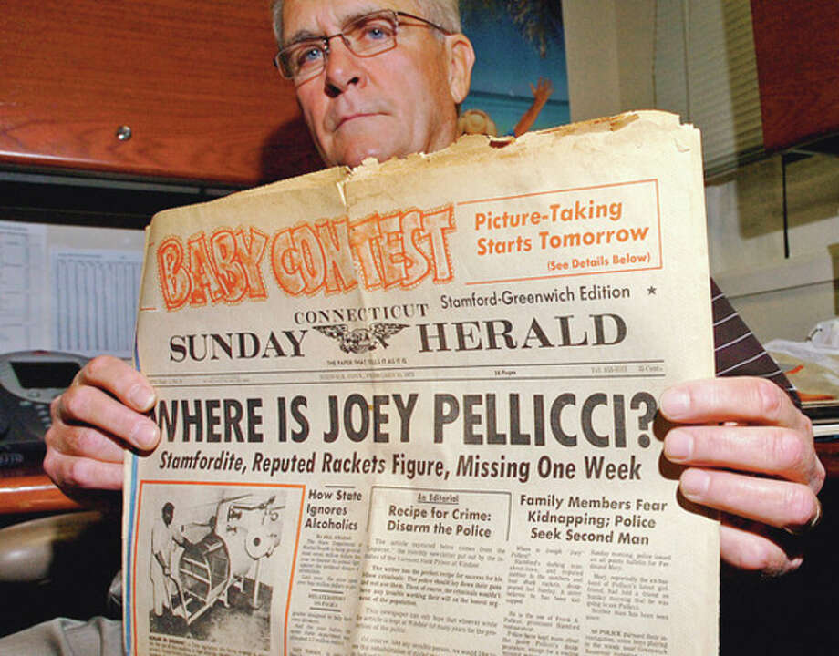 Stamford Detective Anthony Lupinacci holds a newspaper headline about the disappearance of joseph Pellicci in 1973.Hour photo / Erik Trautmann / (C)2011, The Hour Newspapers, all rights reserved