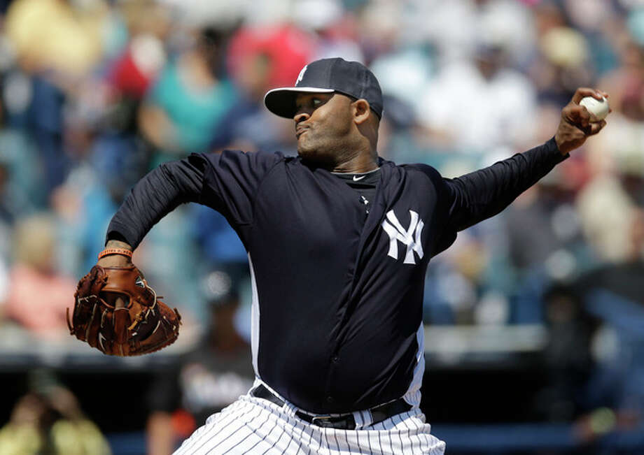 New York Yankees starting pitcher CC Sabathia throws in the second inning of a spring training baseball game against the Miami Marlins in Tampa, Fla., Friday, March 15, 2013. (AP Photo/Kathy Willens) / AP