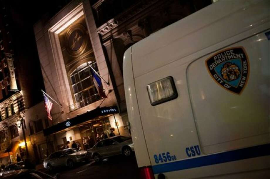 A crime scene unit van sits outside the Sofitel hotel in New York, Saturday, May 14, 2011. Dominique Strauss-Kahn, the leader of the International Monetary Fund and a possible candidate for president of France, was pulled from an airplane moments before he was to fly to Paris and was being questioned Saturday by police in connection with the violent sexual assault of a hotel maid from the Sofitel, police said. (AP Photo/John Minchillo)