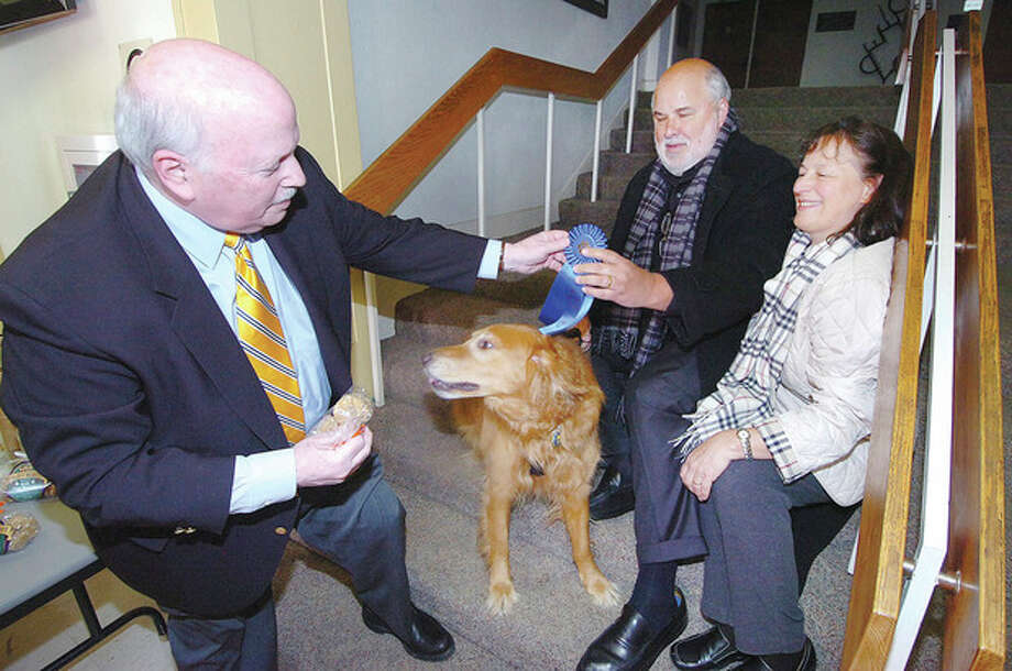 Hour photo / Alex von KleydorffBosco is Westport's 'Top Dog'Westport's Top Dog 'Bosco,' a golden retriever, is awarded the Blue Ribbon by First Selectman Gordon Joseloff. Bosco's owners Alex and Janet Paluch adopted him from the Westport Animal Shelter earlier this year. / 2013 The Hour Newspapers