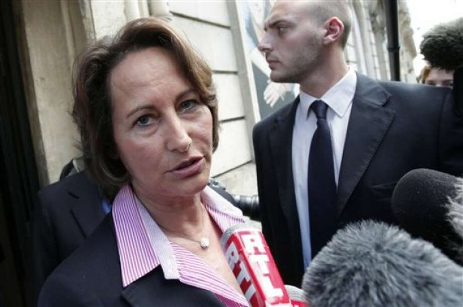 Former French socialist candidate Segolene Royal answers reporters as she leaves Europe1 radio station, in Paris, Sunday May 15, 2011. The arrest of IMF chief Dominique Strauss-Kahn in connection with a sexual assault in New York risks throwing the French presidential race in disarray. Strauss-Kahn is seen as the strongest potential challenger to conservative and unpopular President Nicolas Sarkozy in 2012 presidential elections. (AP Photo/Thibault Camus)