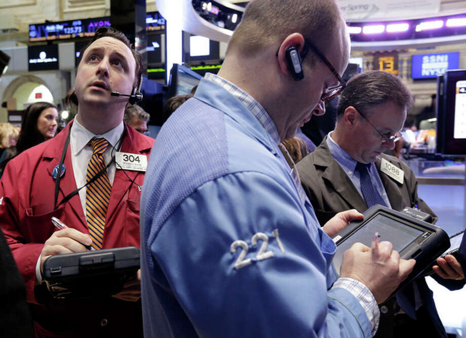Traders work on the floor of the New York Stock Exchange Wednesday, March 13, 2013. Stocks were little changed in early trading on Wall Street after a report showed that retail sales rose more than forecast in February. (AP Photo/Richard Drew) / AP