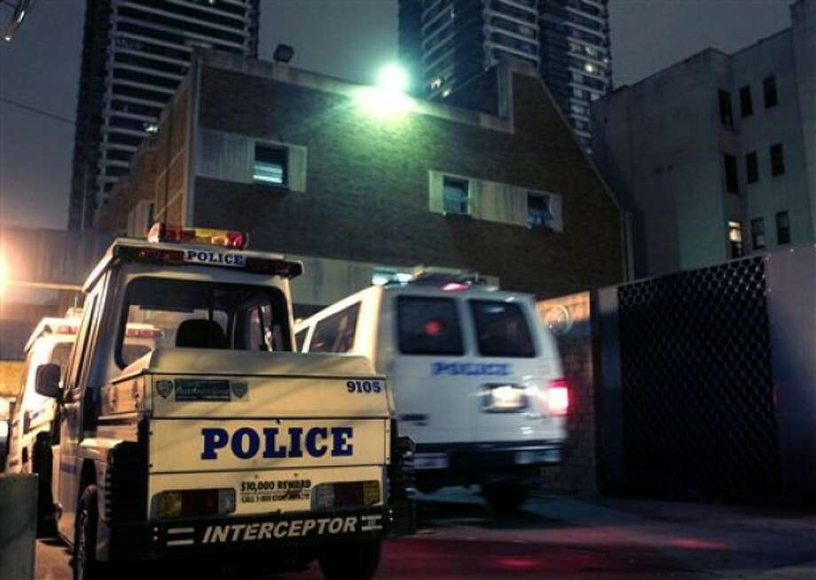 A van pulls into a police station where it is believed Dominique Strauss-Kahn is being held in New York, Sunday, May 15, 2011. Dominique Strauss-Kahn, the leader of the International Monetary Fund and a possible candidate for president of France, was pulled from an airplane moments before he was to fly to Paris and was being questioned Saturday by police in connection with the violent sexual assault of a hotel maid, police said. (AP Photo/Seth Wenig)