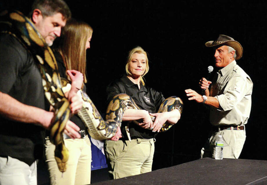 Jack Hanna visits the Maritime Aquarium Thursday to speak about his adventures in the wild and display some animal including a Python as part of the aquarium's Global Insights series.Hour photo / Erik Trautmann / (C)2013, The Hour Newspapers, all rights reserved