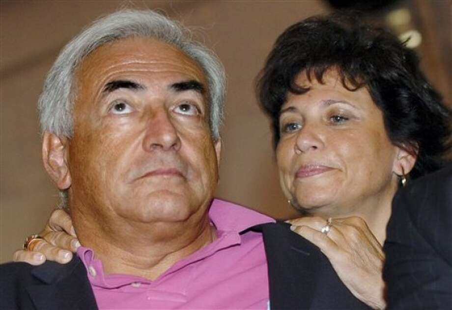 FILE - Then French Socialist Party leader Dominique Strauss-Khan, left, and his wife Anne Sinclair are seen in this Aug. 27, 2006 file photo at the French Socialist summer meeting in La Rochelle, southwestern France. Strauss-Kahn was arrested at 2:15 a.m. Sunday May 15, 2011 on charges of a criminal sex act, attempted rape and unlawful imprisonment, and was awaiting arraignment, police said. Strauss-Kahn is a married father of four. His third wife, Anne Sinclair, is a New York-born journalist who hosted a popular weekly news broadcast in France in the 1980s. (AP Photo/Bob Edme, file)