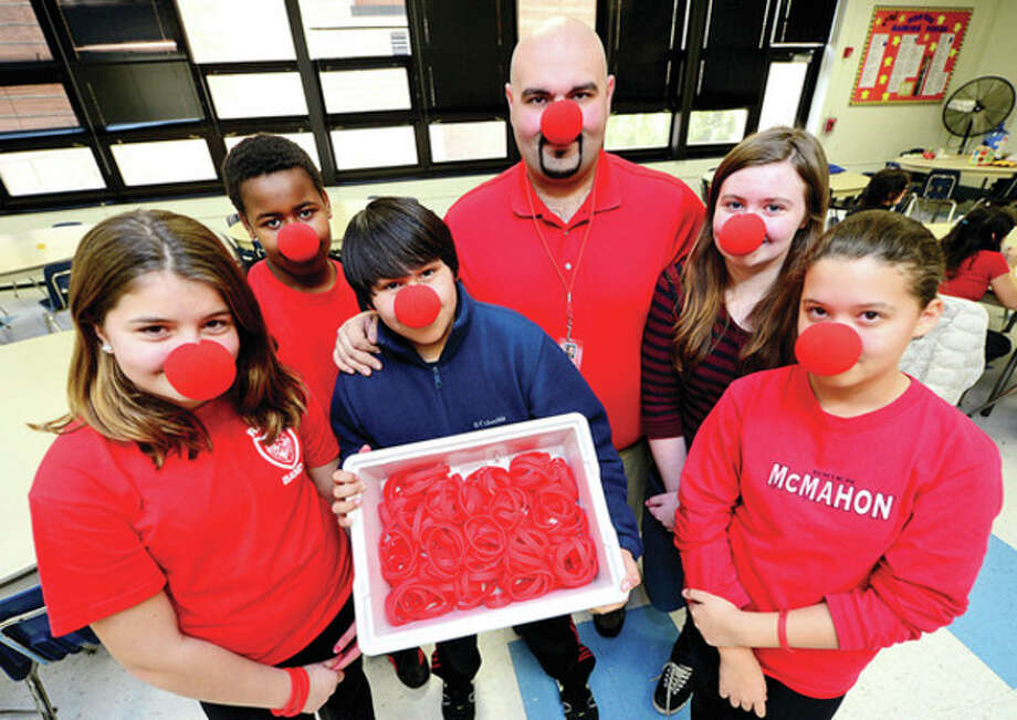 Roton Middle School 7th graders Grace O'Malley, Ethan Mills, Alberto Regalado, teacher Mark Jackson, Ellie Smith and Alison Coutts have put together a / (C)2013, The Hour Newspapers, all rights reserved
