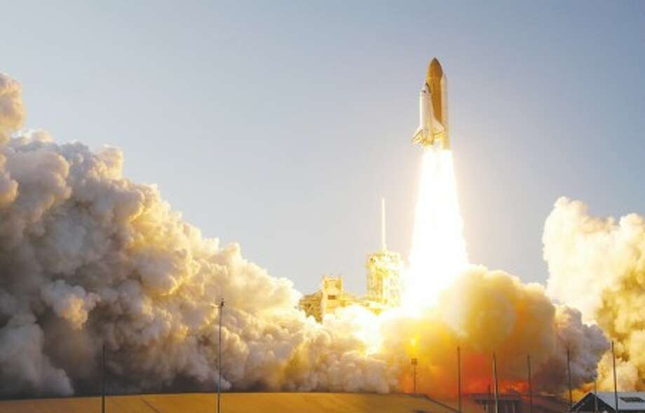 Space shuttle Discovery lifts off from Pad 39A at the Kennedy Space Center in Cape Canaveral, Fla., Thursday, Feb. 24, 2011. Discovery on its last mission, will carry the Leonardo Permanent Multipurpose Module, or PMM, to the International Space Station.(AP Photo/John Raoux)
