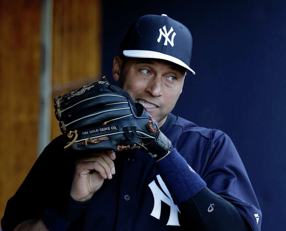 New York Yankees shortstop Derek Jeter (2) adjusts the laces on his glove before a spring training baseball game against the Philadelphia Phillies in Tampa, Fla., Wednesday, March 13, 2013. (AP Photo/Kathy Willens) / AP