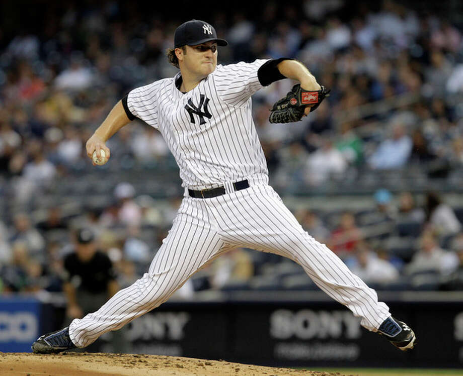New York Yankees starting pitcher Phil Hughes delivers in the first inning against the Kansas City Royals during their baseball game at Yankee Stadium in New York, Tuesday, May 22, 2012. (AP Photo/Kathy Willens) / AP