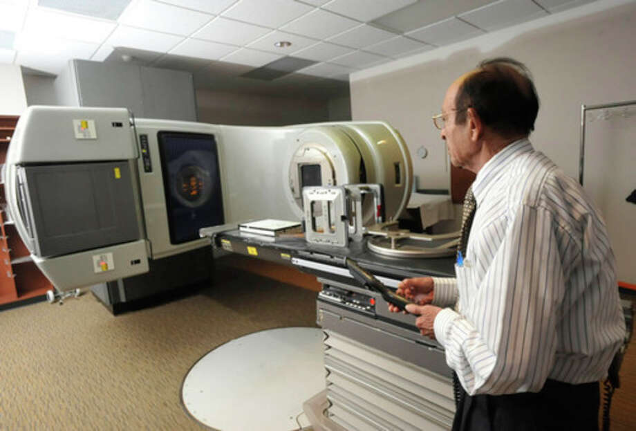 FILE - This Wednesday, Sept. 19, 2102 file photo shows a linear accelerator used to treat cancer at a hospital in Johnstown, Pa. Women treated with radiation for breast cancer are more likely to develop heart problems later, even with the lower doses used today, troubling new research suggests. The risk comes from any amount of radiation, starts five years after treatment and lasts for decades, doctors found. Patients shouldn't panic - radiation has improved cancer survival and that is the top priority, doctors say. The chance of suffering a radiation-induced heart problem is fairly small. The study appears in the Thursday, March 14, 2013 New England Journal of Medicine. (AP Photo/Tribune-Democrat, John Rucosky) THE MORNING CALL OUT; DAILY AMERICAN OUT; WJAC-TV OUT / The Tribune-Democrat