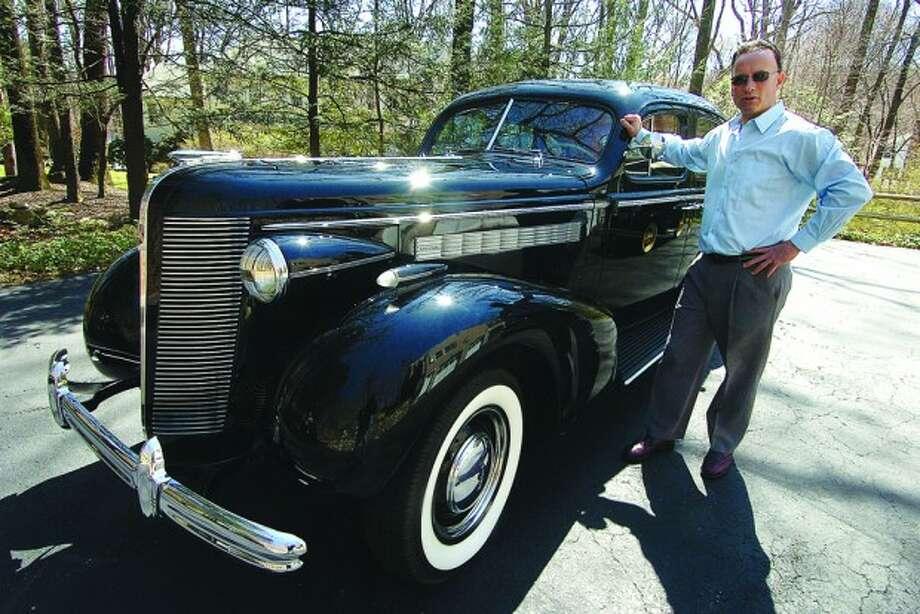 Photo/Alex von Kleydorff. Tony Panaro with his 1937 Buick Special Slant Back.
