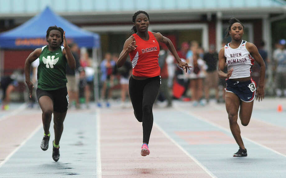 Hour photo/John NashBrien McMahon's Shellyann Lindo, center, races to the FCIAC Championship in the 100-meter run during Tuesday's league championship meet in Danbury. Norwalk's Crystle Hill, left, and McMahon's Sarah Boyd also raced in the final.