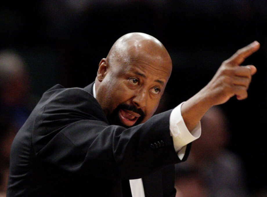 FILE - This March 14, 2012 file photo shows New York Knicks interim head coach Mike Woodson calling out to his team during the first half of an NBA basketball game against the Portland Trail Blazers, in New York. A person with knowledge of the situation says the Knicks and Woodson are finalizing a multiyear deal that could be announced this week. (AP Photo/Frank Franklin II, File) / AP2012