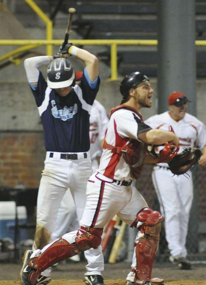 Hour Photo/John Nash Norwalk catcher Kevin Daniele, right, reacts after StamfordÕs Mike Summa, left, strikes out to end NorwalkÕs 10-8, come-from-behind victory in Tuesday nightÕs American Legion baseball state tournament game. The victory put Post 12 into position to play in the state final for the first time in program history.