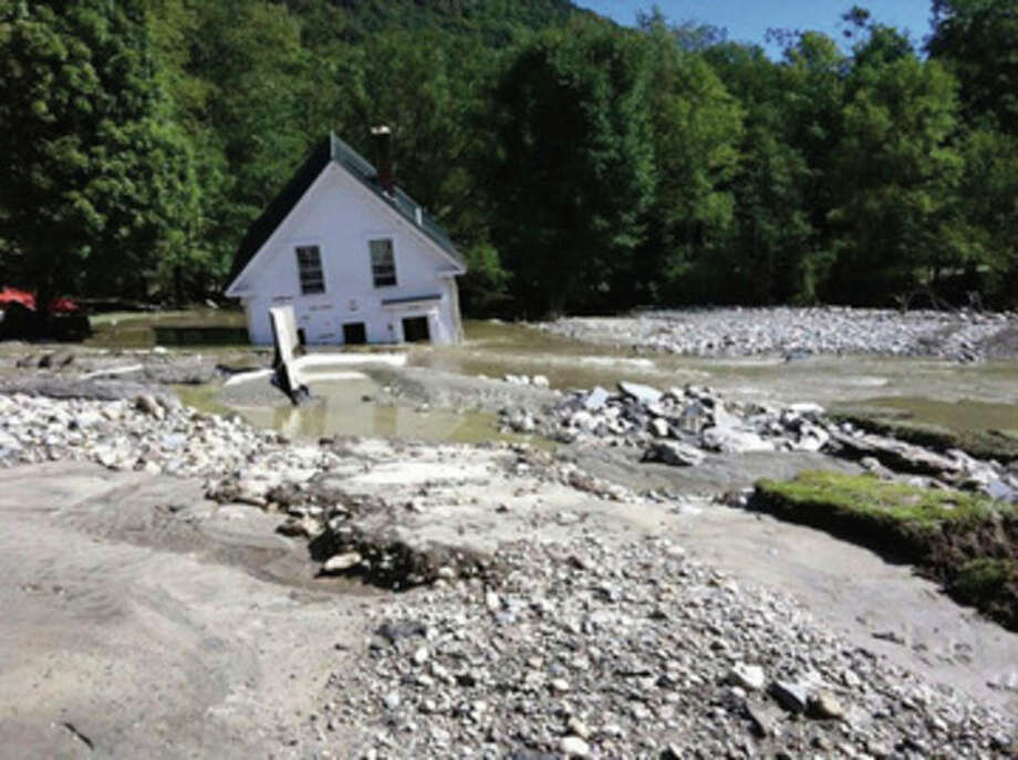 AP photo / Marc Leibowitz A home in Pittsfield, Vt., is shown submerged after Tropical Storm Irene passed through on Sunday. / Marc Leibowitz