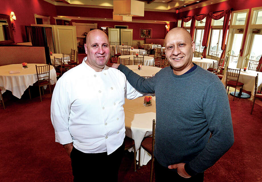 Amar Mouri, owner of Oak Hills Restaurant on the Green, right, and his chef Vincent LaForte. Hour photo / Erik Trautmann / (C)2013, The Hour Newspapers, all rights reserved