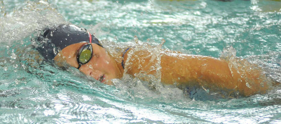 Hour Photo/John Nash Wilton freshman Julia Lewis swims the 500 free during Monday's season-opening meet agaist Fairfield Warde at the Wilton Y. Lewis placed second in the event in 6:02.1. The Warriors defeated Warde, 100-68.