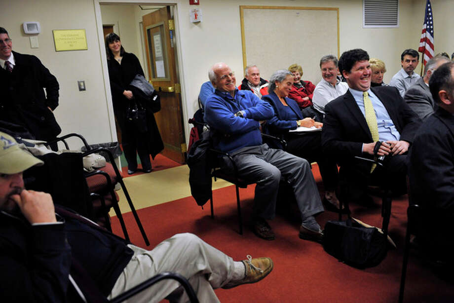 In this Tuesday, Jan. 10, 2012 photo, Republican candidate for U.S. Senate Chris Shays, center, laughs during a Republican Town Committee meeting in Durham, Conn. Shays, a former 11-term U.S. Representative, is challenging former WWE CEO Linda McMahon for the Republican nomination of the U.S. Senate seat vacated by retiring Sen. Joe Lieberman. (AP Photo/Jessica Hill) / AP2012