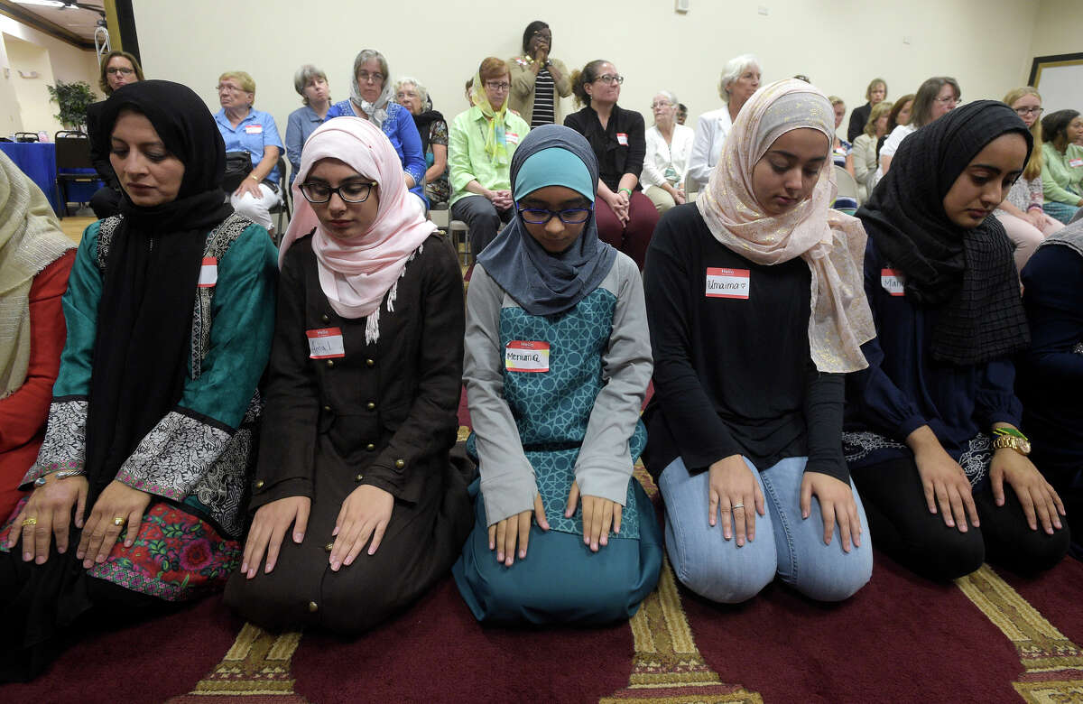 Non-Muslim members of the community watch a special prayer at the American Muslim Community Center in Longwood, Fla., after the mass-shooting at the Pulse Orlando nightclub.