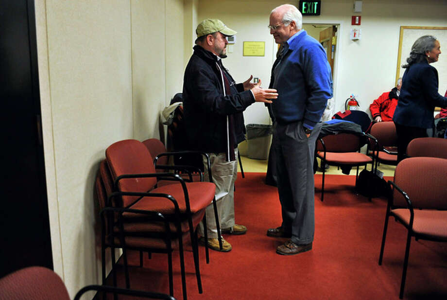 In this Tuesday, Jan. 10, 2012 photo, Republican candidate for U.S. Senate Chris Shays, right, listens to Jay Berardino during a break at a Republican Town Committee in Durham, Conn. Shays, a former 11-term U.S. Representative, is challenging former WWE CEO Linda McMahon for the Republican nomination of the U.S. Senate seat vacated by retiring Sen. Joe Lieberman. (AP Photo/Jessica Hill) / AP2012