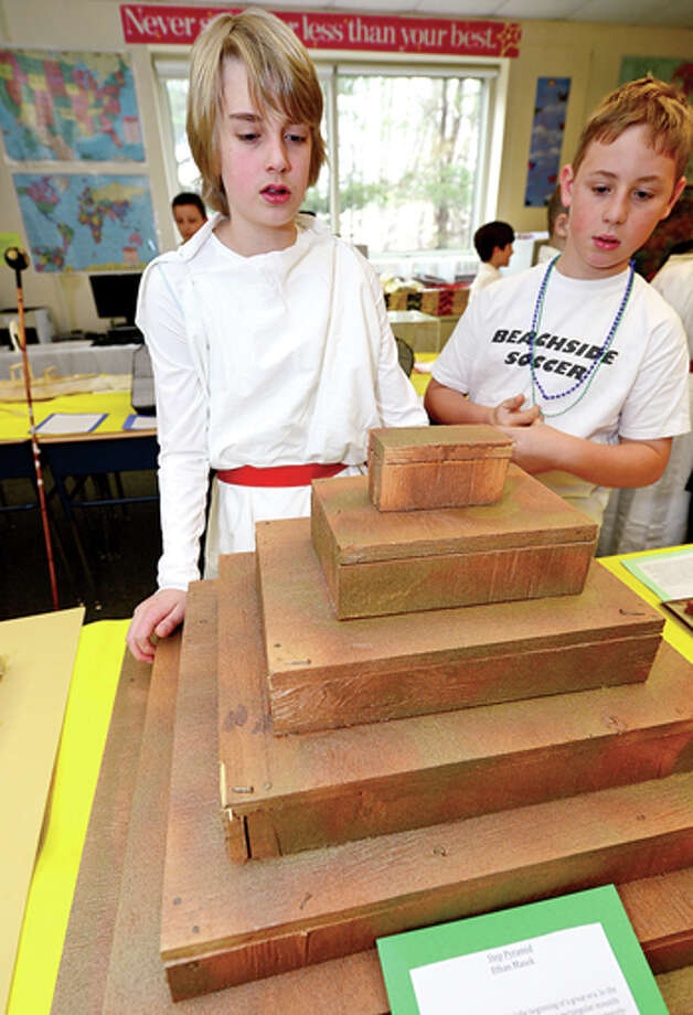 Middlebrook Middle School's 6th grade Yellow Team students including Ethan Masek who describes his Step Pyramid of Djoser project to classmate Cameron Farrar during the school's 14th annual Egypt Day Friday. Hour photo / Erik Trautmann / (C)2013, The Hour Newspapers, all rights reserved