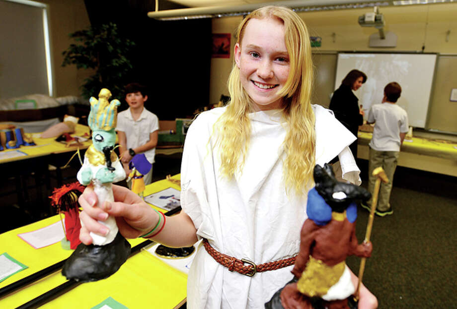 Middlebrook Middle School's 6th grade Yellow Team students including Kater Sellert created a museum of artifiacts with her staures of Osyrius and Set in their classroom during the school's 14th annual Egypt Day Friday. Hour photo / Erik Trautmann / (C)2013, The Hour Newspapers, all rights reserved