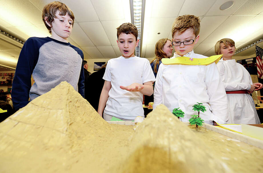 Middlebrook Middle School's 6th grade Yellow Team members including Clayton Latone, who explains his Pyramids of Giza project to 6th graders Ryan Frankel and Ryan Edkins, participate in the school's 14th annual Egypt Day, an interdisciplinary unit focused on Egypt Friday. Hour photo / Erik Trautmann / (C)2013, The Hour Newspapers, all rights reserved