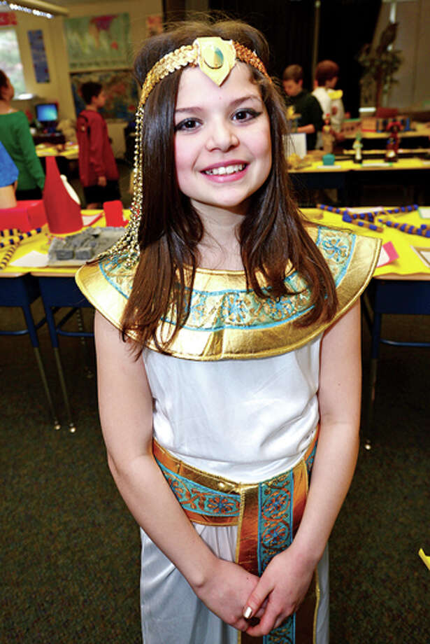 Middlebrook Middle School's 6th grade Yellow Team student Stella Araujo and her class created a museum of artifiacts in one of their classroom as part of the schools 14th annual Egypt Day Friday. Hour photo / Erik Trautmann / (C)2013, The Hour Newspapers, all rights reserved