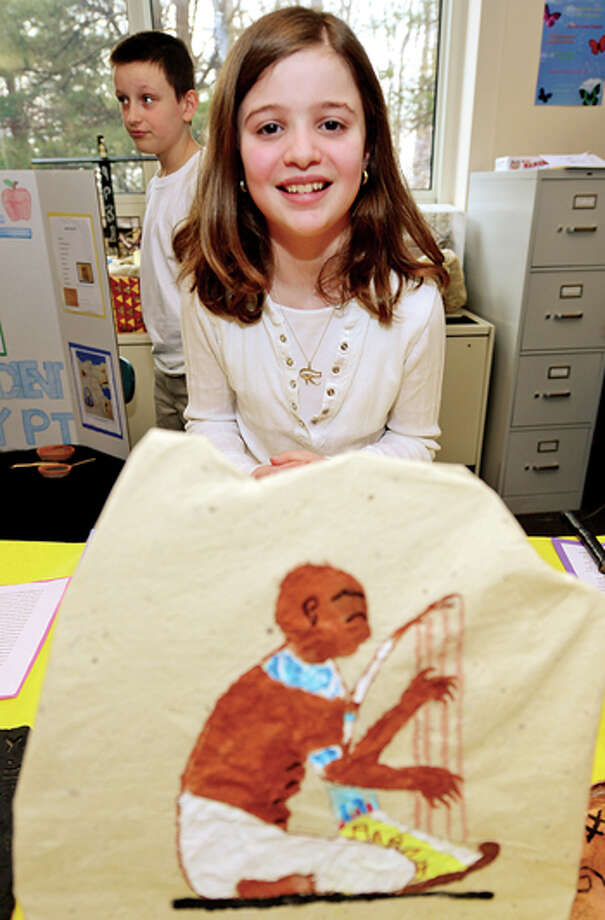"Middlebrook Middle School's 6th grade Yellow Team students including Maddie Davison created a museum of artifiacts like her ""Song of the Harper"" as part of the school's 14th annual Egypt Day Friday. Hour photo / Erik Trautmann / (C)2013, The Hour Newspapers, all rights reserved"