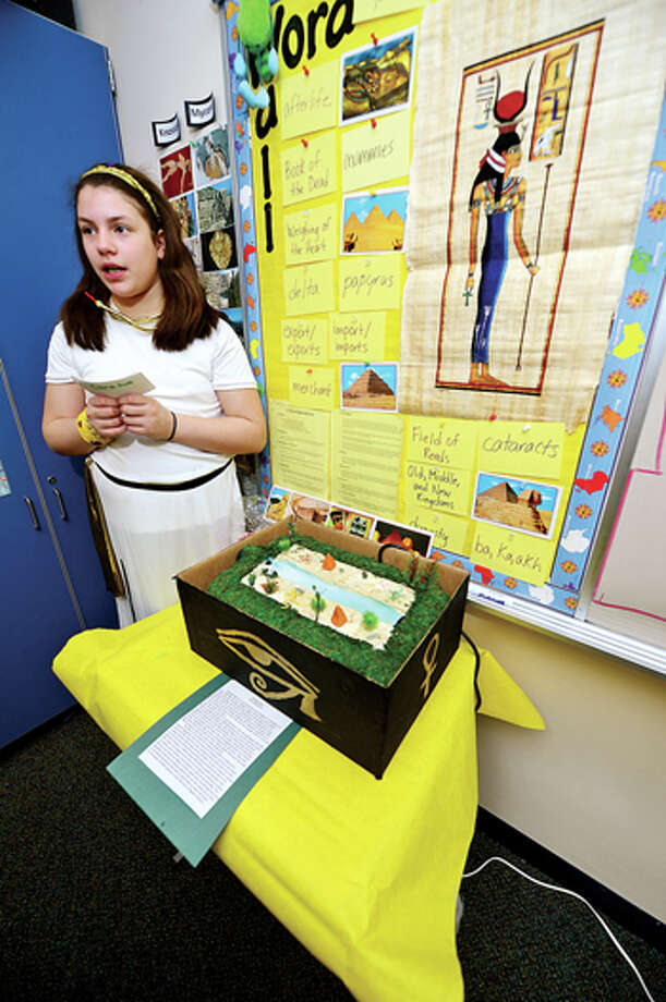 Middlebrook Middle School's 6th grade Yellow Team student Olivia Benjamin explains her project on the Nile, during the school's 14th annual Egypt Day Friday. Hour photo / Erik Trautmann / (C)2013, The Hour Newspapers, all rights reserved