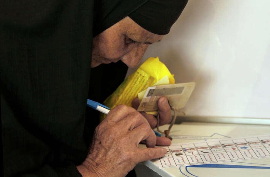 An Egyptian woman votes during the first day of the presidential election in a polling station in Alexandria, Egypt, Wednesday, May 23, 2012. Egyptians went to the polls on Wednesday morning to elect a new president after the fall of ex-President Hosni Mubarak last year. (AP Photo/Khalil Hamra) / AP