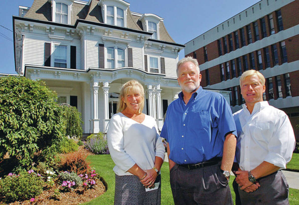 The three Magner siblings, Maribeth Hemingway, Michael Magner and Jay Magner, are thefourth generation to operate Norwalk's Magner Funeral Home. Hour photo / Erik Trautmann