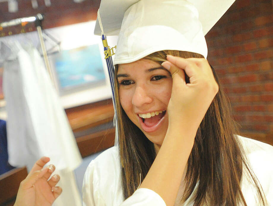 Briggs High School graduate Alyssa Aguilar prepares for the commencement ceremony Monday night at Norwalk Community College. hour photo/matthew vinci / (C)2011, The Hour Newspapers, all rights reserved