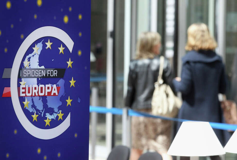 A euro logo is seen that reads in Danish: 'The head of the EU', referring to the Danish EU presidency, at the European Council building in Brussels, Tuesday, May 22, 2012. At Wednesday's informal meeting of the EU's 27 leaders in Brussels, newly elected French President Francois Hollande is expected to push for so-called eurobonds, which can be used to fund investments or boost banks' capital reserves. (AP Photo/Yves Logghe) / AP