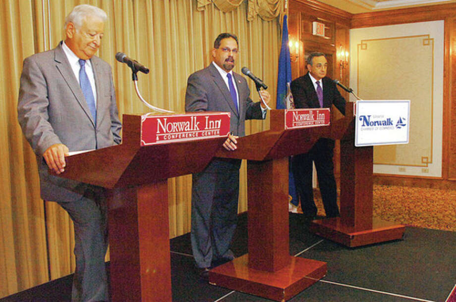 News 12 news director Tom Appleby, right, moderates the Greater Norwalk Chamber of Commerce Mayoral Debate between Mayor Richard Moccia and Democrat Andy Garfunkel Thursday at the Norwalk Inn. Hour photo / Erik Trautmann / (C)2011, The Hour Newspapers, all rights reserved