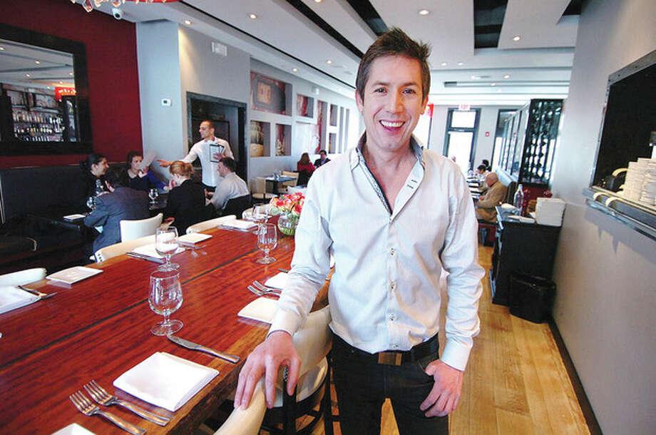 Hour photo / Alex von KleydorffMario Lopez IN his Bianco Rosso Restaurant in Wilton. / 2013 The Hour Newspapers