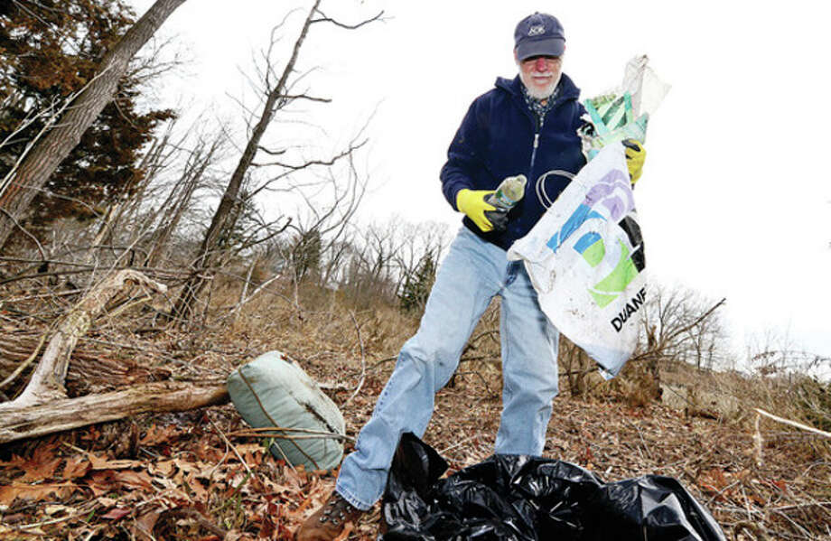 Hour photo / Erik TrautmannArt Heilman on Hart Peninsula during The Norwalk Land Trust major storm cleanup at Farm Creek Preserve on Sammis Street in Rowayton Saturday. / (C)2013, The Hour Newspapers, all rights reserved