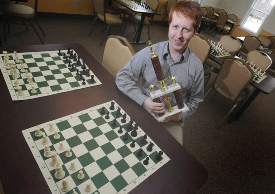 Hour photo / Matthew VinciNorwalk native Ian Harris won the Connecticut State Chess Championships at the Hopkins School in New Haven. Nine years ago, as a junior at Norwalk High School, Harris won the Connecticut Scholastic Chess Championships and earned a competitive spot at the Denker National Championships, an annual event that brings together all the high school champions from the 50 states.