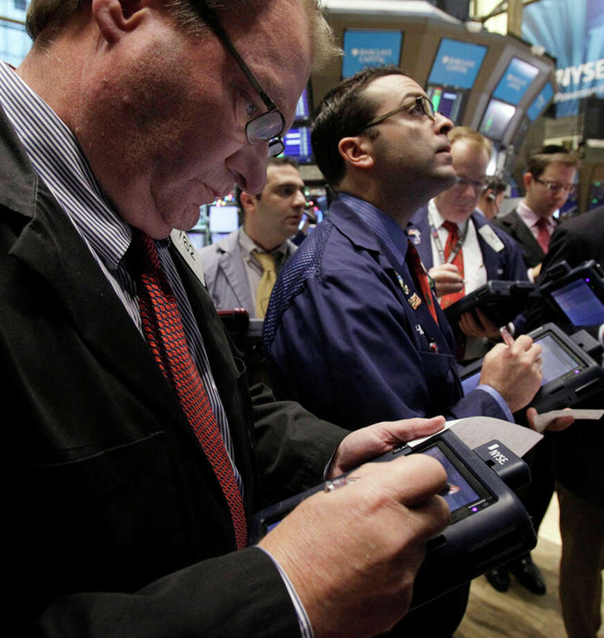 Traders work on the floor of the New York Stock Exchange Monday, Dec. 5, 2011. Stocks rose broadly in early trading Monday on hopes for a plan to restore long-term confidence in the euro. (AP Photo/Richard Drew) / AP