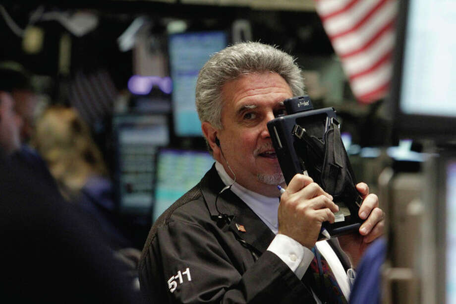 A trader works on the floor of the New York Stock Exchange Wednesday, Aug. 10, 2011. (AP Photo/Richard Drew) / AP